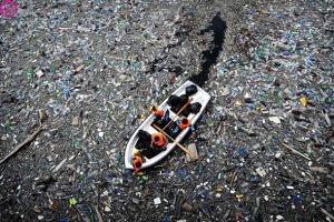 Fig1-boat-in-plastic-river