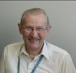 Headshot of a smiling older man, Ted Park.