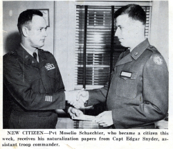 Elio shaking the hand of his commanding officer.