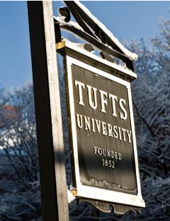 A wooden sign reading 'Tufts University, founded 1852'.